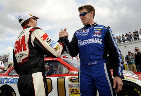 Roush Fenway drivers Greg Biffle (left) and Carl Edwards celebrate their sweep of the top positions in the Daytona 500.