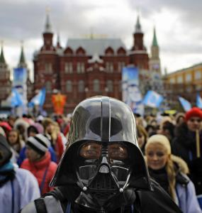 A member of the pro-Kremlin youth movement Stal wearing a Darth Vader mask participates in a rally in downtown Moscow, in December.