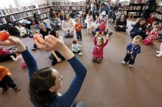 Bethany Templeton Klem leads preschoolers in the Move and Groove program at the Saugus Public Library on Feb. 10.
