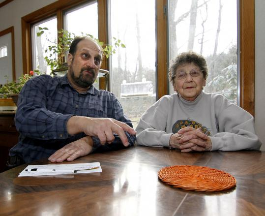 Craig Edwards and his mother, Doris, are concerned about the impact of large houses being built in their Sharon neighborhood.