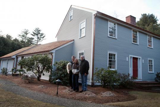 Dr. Michael J. Yaremchuk and his wife, Marilynn, decided to keep their house in Lynnfield, hiring contractor Blaise Scioli (right) to renovate.