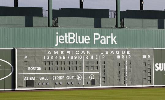 The new JetBlue Park in Fort Myers, Fla., has an old manual scoreboard from Fenway Park and displays Red Sox players' retired numbers (alongside Jackie Robinson's 42).