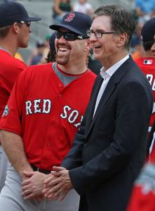 Sox owner John Henry didn't address the full team yesterday, but he and Kevin Youkilis shared a moment.