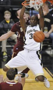 In the first half, Wake Forest forward Travis McKie powers home a pair of his 21 points.