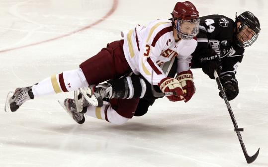 Patch Alber delivers a big hit that sends Providence's Myles Harvey to the ice during BC's win.