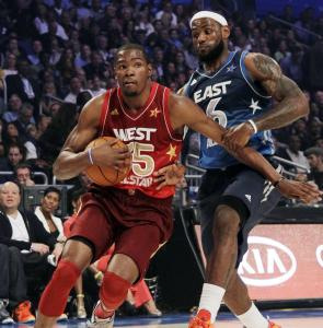 The East's LeBron James in his rear-view mirror, the West's Kevin Durant cradles the ball on his way to the basket.