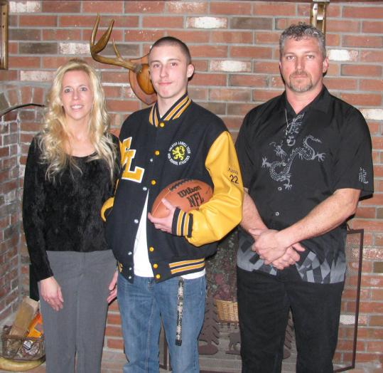 Anthony Manning III, who had a heart transplant at age 8, with his parents, Debbie and Anthony Manning Jr.