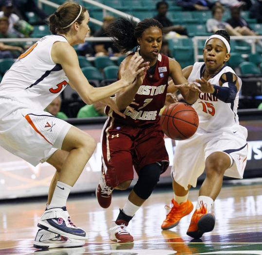 BC's Tessah Holt (center) tried to split Virginia's defenders, but the bounces didn't go the Eagles' way in a 7-23 season.