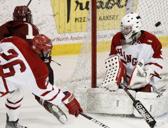 BC High's Tom Besinger (11) scores his second goal of the game in a victory over Hingham.