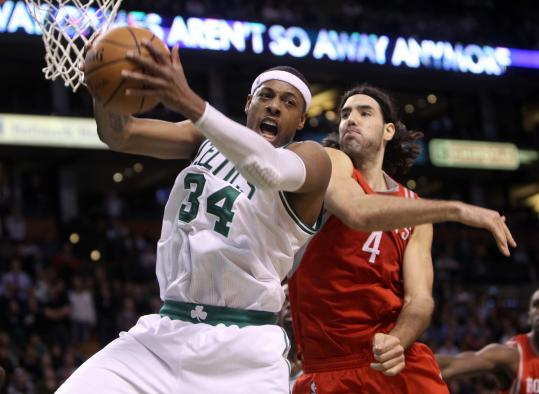 Paul Pierce, beating Luis Scola to a rebound, took control in OT, with 7 of his 30 points.