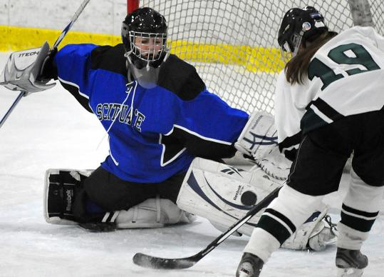 Clockwise from top: Scituate goalie Hannah Clougherty tries to stop a shot from Westwood's Kelly Healey Friday night in Canton; Westwood's Elizabeth Stuehr (left) moves in on Scituate's Katy McMahon; Scituate coach Caitlyn Donnelly coaches her team in the second period. Scituate lost, 8-1.
