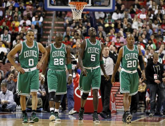 Discouraged Celtics (from left) Avery Bradley, Mickael Pietrus, Kevin Garnett, and Ray Allen walk off the court during a break.