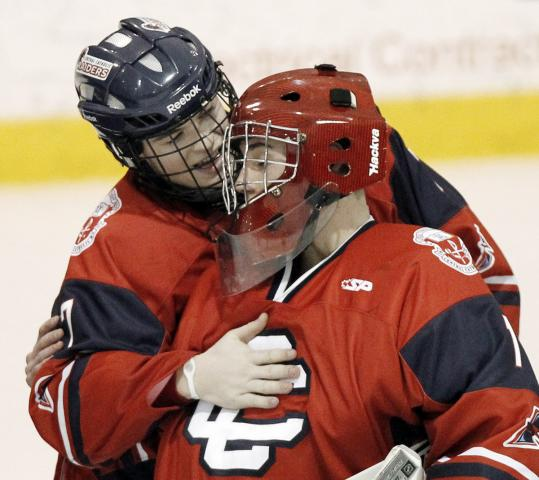 Central Catholic's Jake Donahue, who scored the winner, congratulates goalie Andrew Robbins after their victory.