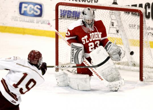 BC High's Matt Sullivan zips the winner past St. John's of Shrewsbury goalie Mario Pizzeri.