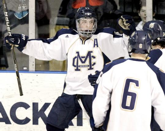 With open arms, Ryan Fitzgerald accepts congratulations from his Malden Catholic teammates after one of his three goals.