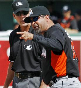 Marlins manager Ozzie Guillen (right) was ejected in the sixth, then he received a sendoff from Sox manager Bobby Valentine.