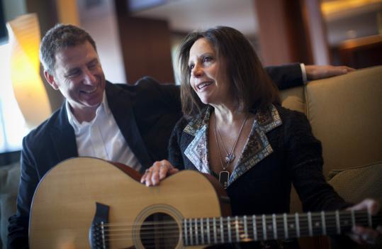 Joyce Benka sits with local musician Vin Colella in Boston last month after retrieving a guitar that her late son, Adam, had sold to raise cash.