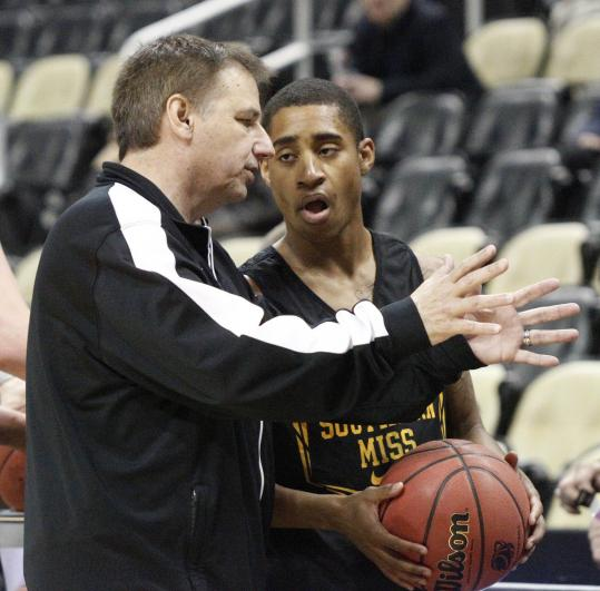 Southern Mississippi coach Larry Eustachy, with Neil Watson, is back in the limelight after a very public fall from grace.