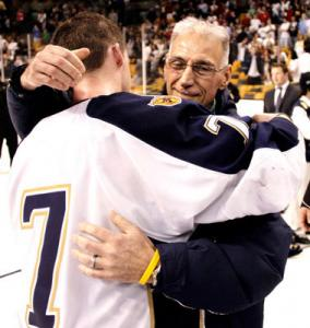 Malden Catholic's Brendan Collier receives a hug from ailing coach Chris Serino following the Lancers' Super 8 victory.