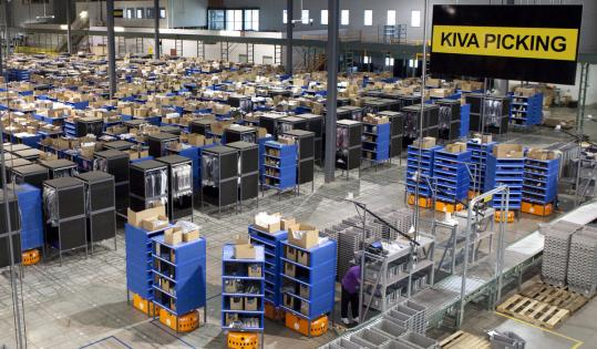 Kiva Systems' robots shuttled merchandise around a Gilt Groupe distribution center in Shepherdsville, Ky.