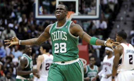 The Celtics' Mickael Pietrus has this reaction after making a 3-point shot during the second half against the Hawks.