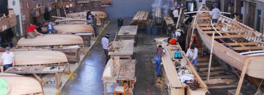 Wooden boats are built at the International Yacht Restoration School, which welcomes visitors. The school is also hosting a free spring lecture series.