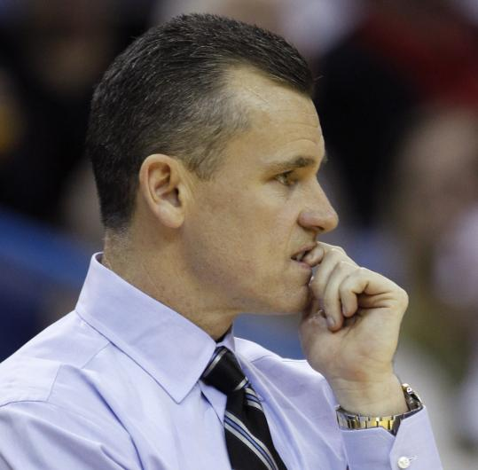 Florida coach Billy Donovan (above) will lead his Gators against mentor Rick Pitino and Louisville.