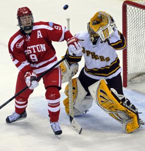 Minnesota goaltender Kent Patterson and BU's Alex Chiasson set their sights on a loose puck during first-period action.
