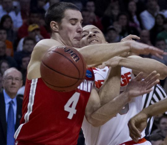 Ohio State's Aaron Craft (left) got whistled for the foul defending Syracuse's Brandon Triche.