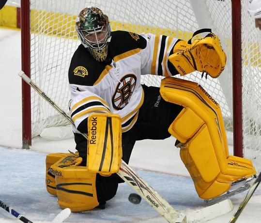 Marty Turco makes one of his 25 saves, this one in the third period vs. the Ducks, during his first win with the Bruins.