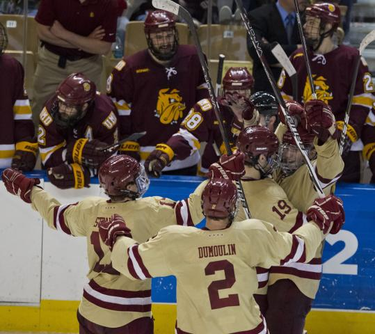 Patrick Wey (right) is the object of a stick-raising celebration after his floater from the boards gave BC a 3-0 lead in the third.