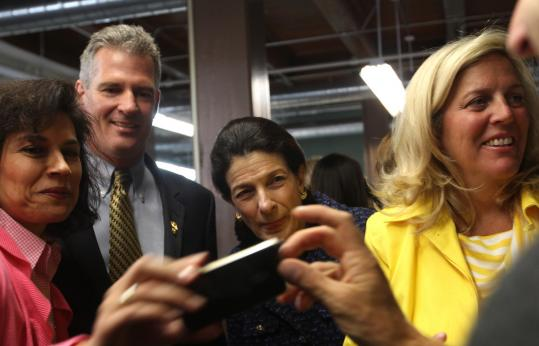 Supporters gathered around Senators Scott Brown and Olympia Snowe (center) after the launch of Women for Brown Coalition at Brown's headquarters Monday. The senator has signaled that he will fight hard for female voters.