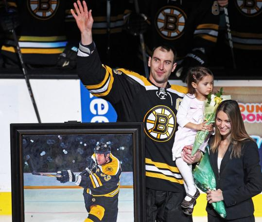 Zdeno Chara waves to the Garden crowd as his wife Tatiana and daughter Elliz Victoria look on during a pregame ceremony honoring his 1,000th NHL game.