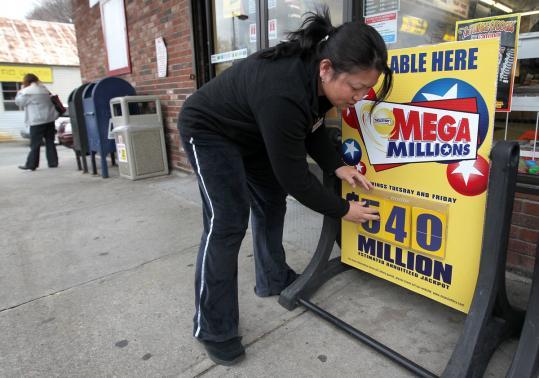 Store manager Gloria El-Shurafa changed the Mega Millions jackpot outside the Tedeschi on Neponset Avenue to $540 million.