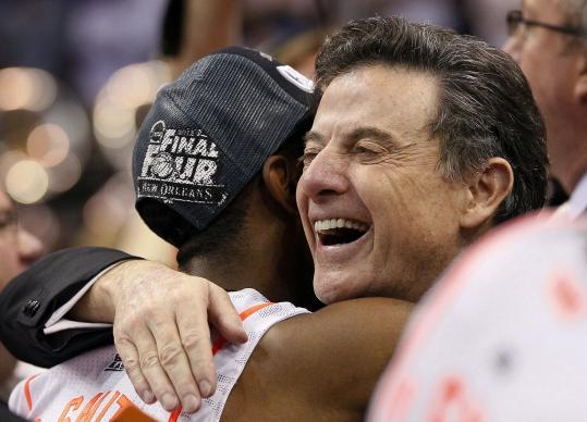 Louisville coach Rick Pitino, hugging Russ Smith after a win over Florida, will be a formidable opponent for Kentucky in Saturday's Final Four game.