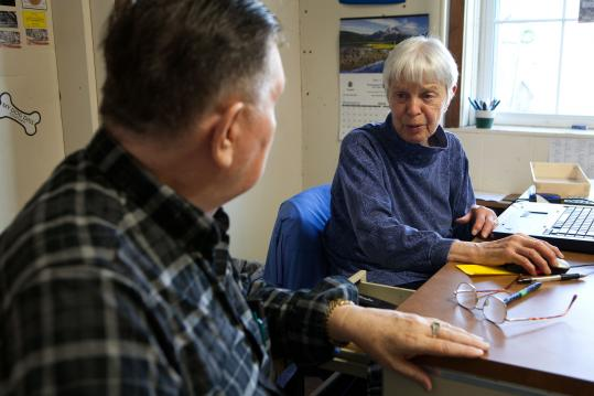 """Marie Messner, a volunteer with AARP Foundation Tax-Aide, helps Jim Seger, 78, of Haverhill, prepare his taxes. """"My mind boggles,'' says Seger."""