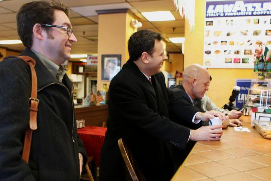 Customers showed up at the cash mob at The Cannoli Guy Café in Malden on Friday. Mayor Gary Christenson (middle) was among those offering support.
