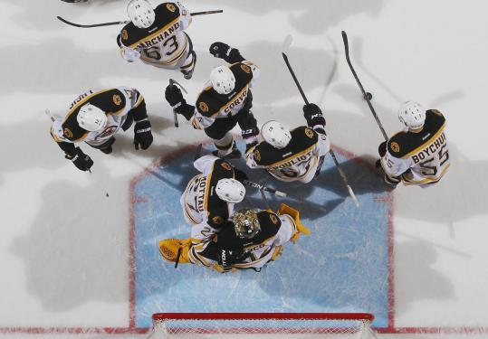The Bruins, who got two goals from David Krejci, celebrate their 6-3 victory over the Islanders Saturday in Uniondale, N.Y.