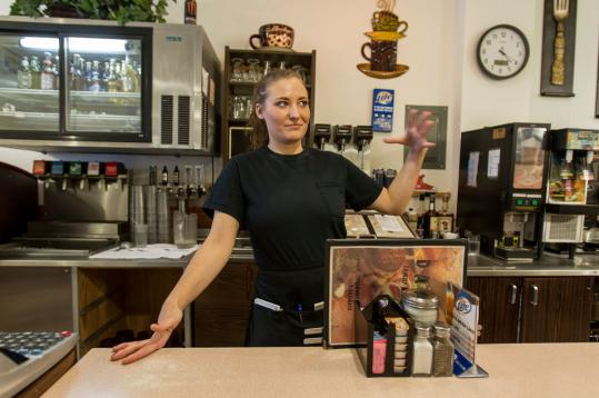 Waitress Samantha Copus of Eagle, Wis., says her family has learned not to discuss recall politics in order to get along.