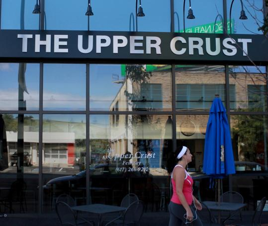 The Upper Crust Pizzeria chain is contending with ongoing federal investigations and lawsuits involving its labor practices.