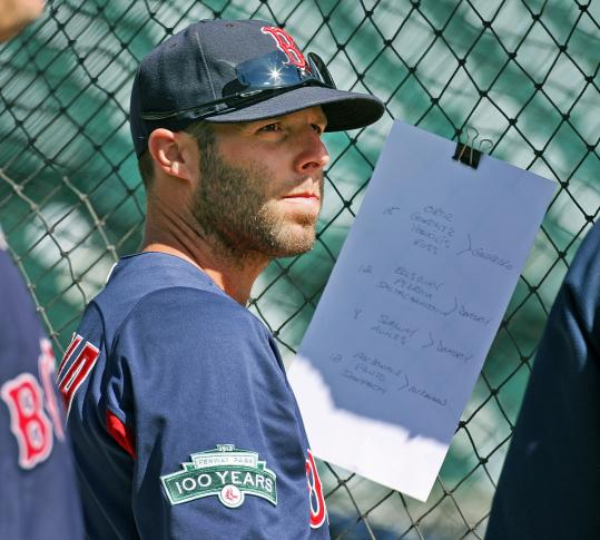 Dustin Pedroia waits for his turn to take batting practice Wednesday at Comerica Park.