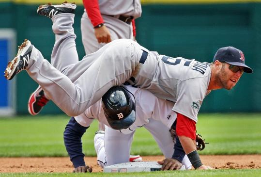 Tigers base runner Austin Jackson can't prevent Dustin Pedroia from turning a first-inning double play.