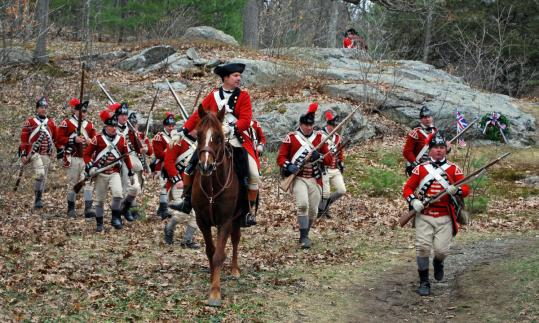 Reenactors playing British regulars at last year's brief staging of Parker's Revenge, a little-known engagement at the start of the American Revolution.