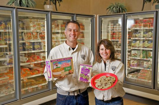 Chris and Paula White of Duxbury with the frozen products produced by their company, 600lb Gorillas Inc.