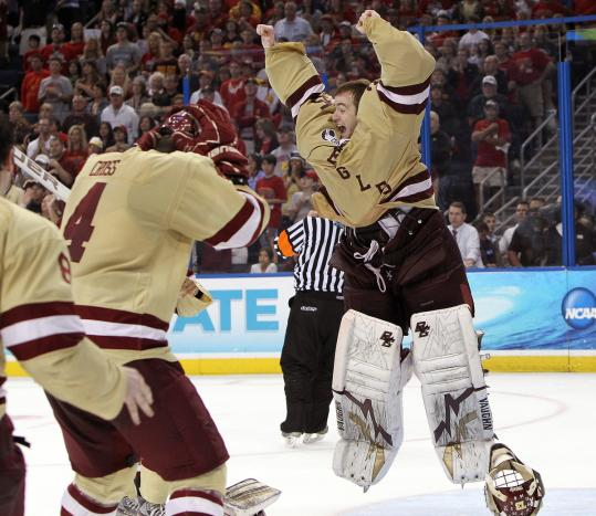 BC goaltender Parker Milner - the Frozen Four's Most Outstanding Player - jumps for joy with his teammates after the Eagles finished off Ferris State.