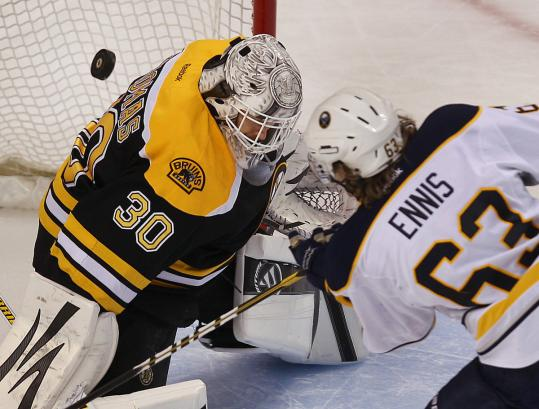 Goalie Tim Thomas turns aside Tyler Ennis&#8217;s shot, one of his three shootout saves in the Bruins&#8217; regular season-ending win.