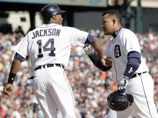 Tigers slugger Miguel Cabrera (right) belted a two-run homer in the first inning at Comerica Park, earning a hearty congratulations from teammate Austin Jackson, who led off with a walk.