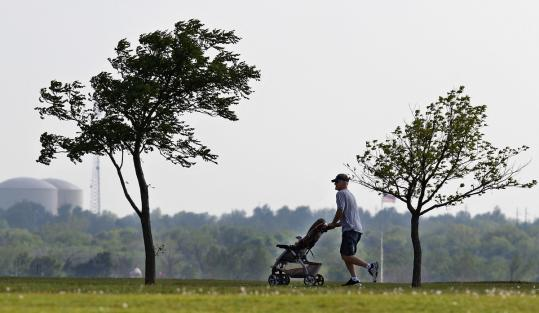 A man in Oklahoma City jogged with his granddaughter last Monday. Temperatures in the lower 48 states were 6 degrees higher than average for the first three months of the year.