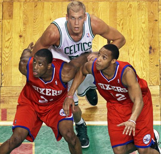 The Celtics&#8217; Greg Stiemsma, who finished with three rebounds, looks for position against the 76ers&#8217; Thaddeus Young (left) and Evan Turner.
