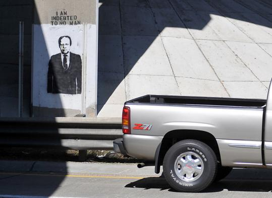 The images of Gerald Ford have sprung up along Interstate 196 in Grand Rapids, Mich., the former president's hometown.